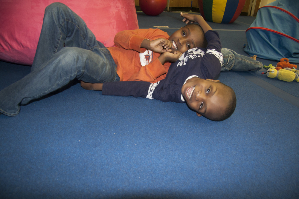 """What we love about AMP Space is it allows Aaron to flop around, crawl & we don't have to worry about him hurting himself. He & Zach play on the floor at home but here I don't have to worry about them bumping their heads on the hard floor. Zach loves the  ball pit . He also digs the  roller slide . They light up when we enter the space."""