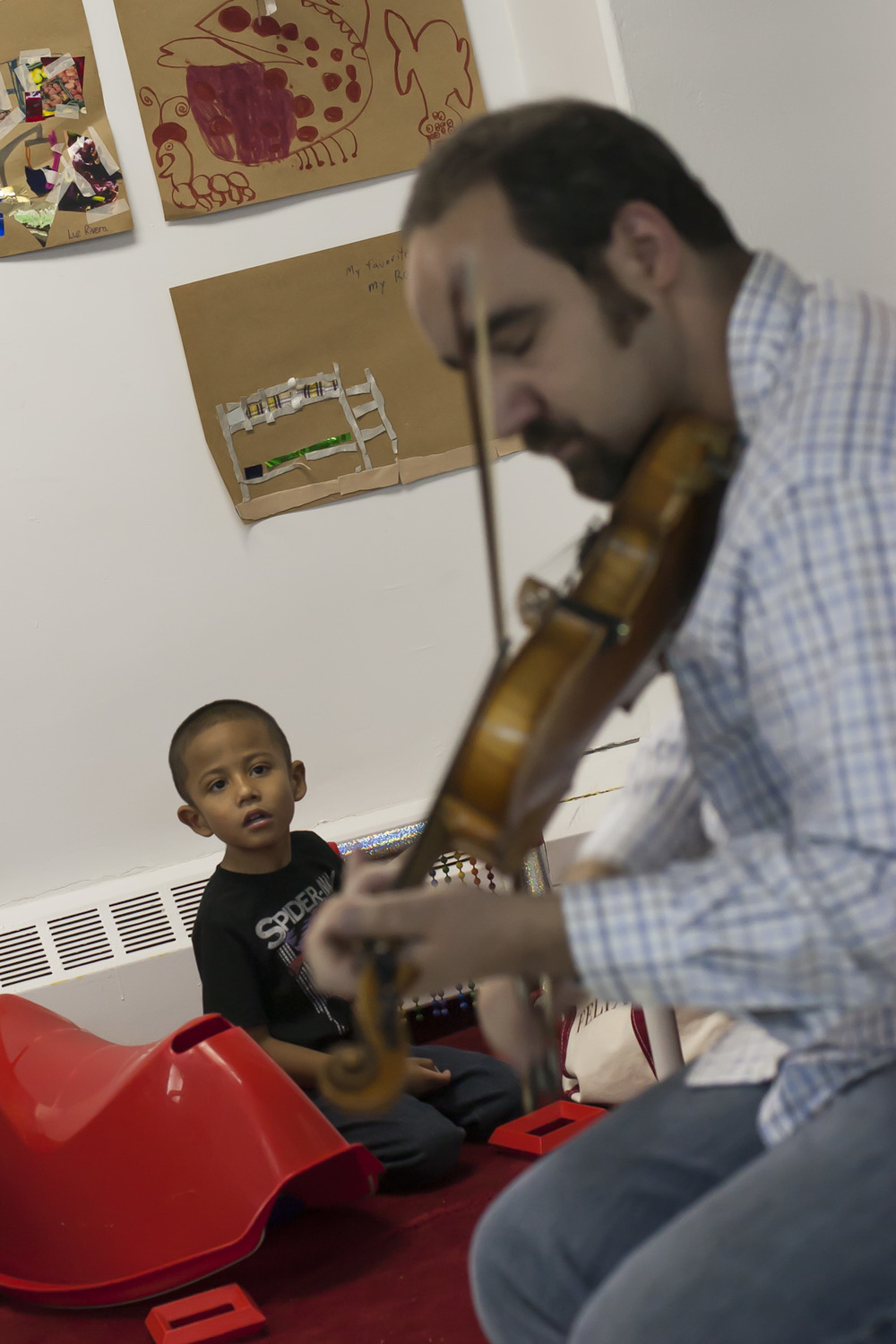 Jamir loves the live music events provided. Jamir is  Autistic  along with having  ADHD . I love seeing how Jamir is mesmerized by the musicians and he actually sits down to watch the performance. Music calms him down, which is a rarity as he loves to explore the play space.