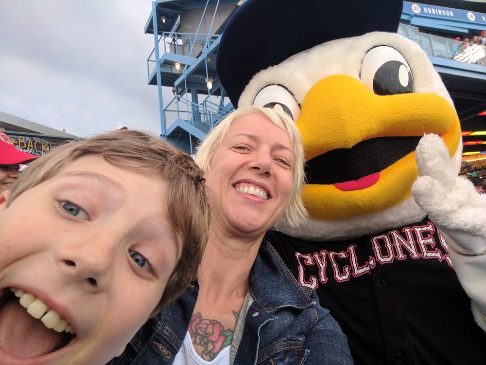 Caitlin, Shane and Cy the mascot, earlier this summer.