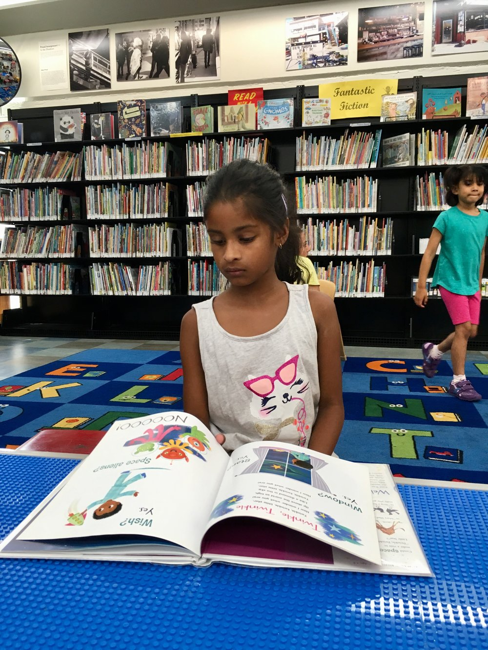 Reading at the library.