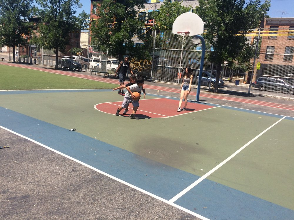 Playing basketball.
