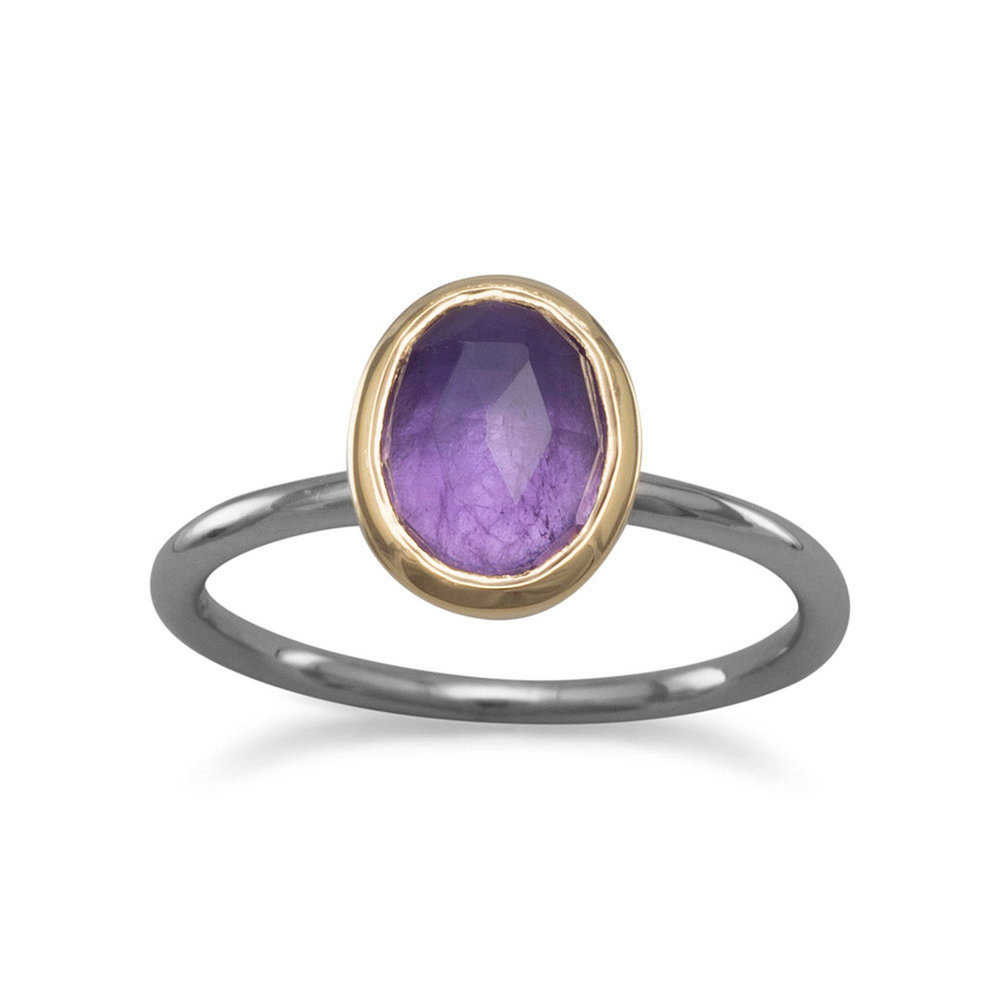 Gunmetal plated sterling silver 1.75mm band with oval amethyst. The 8mm x 10mm faceted amethyst has a 14 karat gold plated sterling silver edge.  $50.00