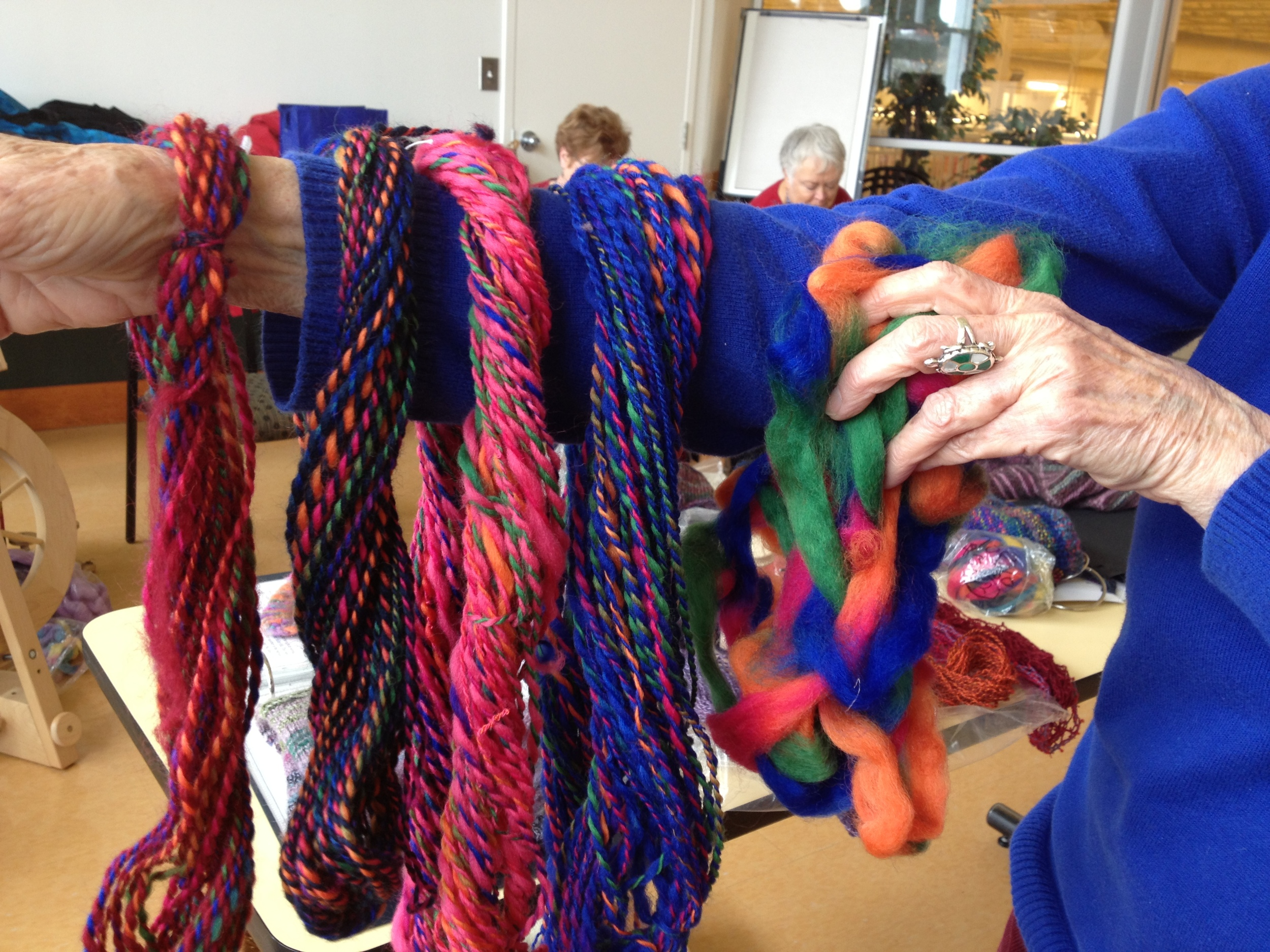 The original multi on the far right, the two samples are on the left, where it has been plyed with a cerise red or a dark blue.