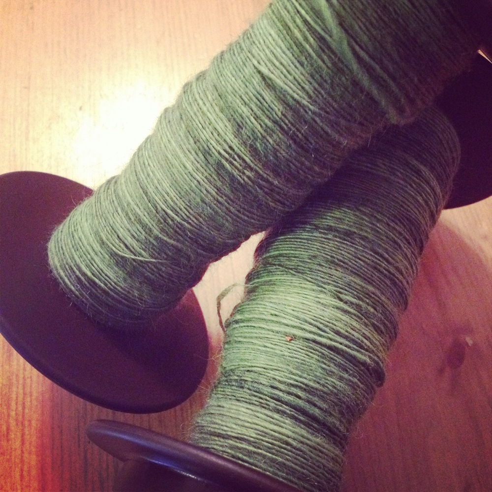 Day 6 - I was home sick from work so I managed to get 100g of singles spun up in this beautiful green hand dyed yarn.
