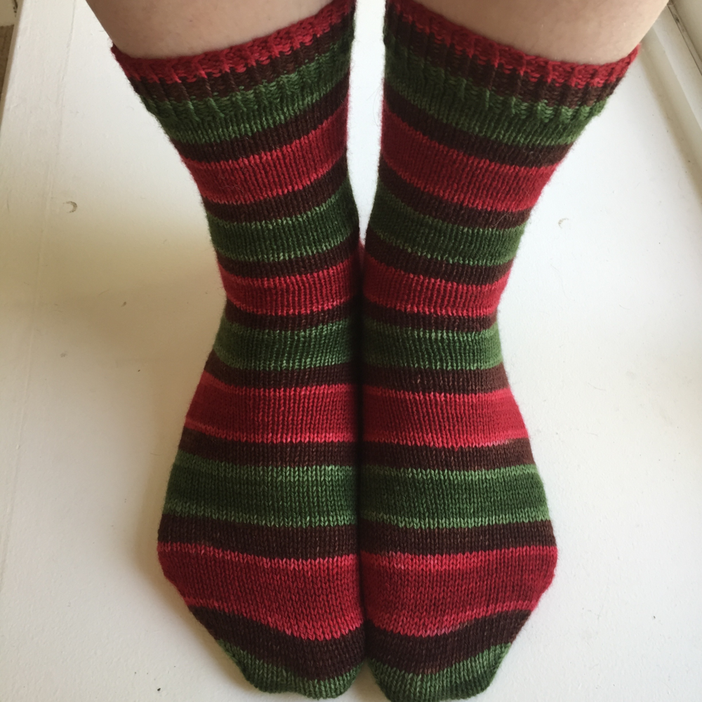 My personal sock pattern for self-striping sock yarn - pattern coming soon.