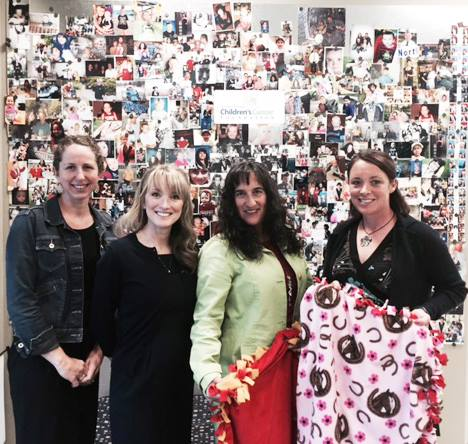 """""""  Lauren Klein, CEO of Girlmade , stopped by to donate these perfect blankets made for Northern Nevada Children's Cancer Foundation kids by local girls at the Girl Empire Conference.""""  [Photo credit: Northern Nevada Children's Cancer Foundation/Facebook]"""