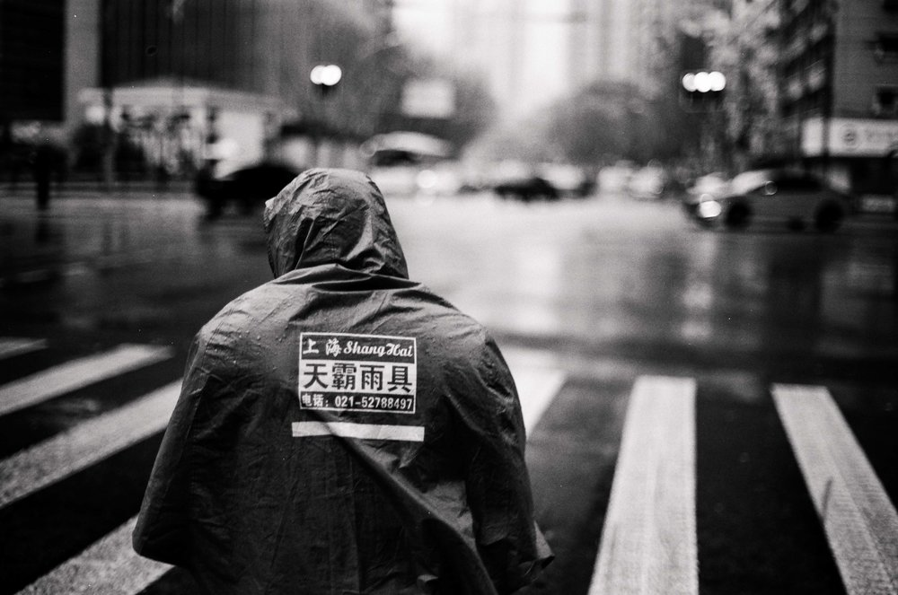 Biking in the Rain // Shanghai, China // 35mm B&W Film // 2014