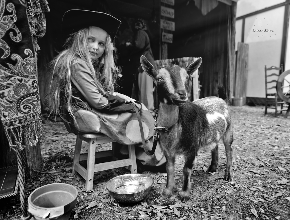 girl and the goats.png