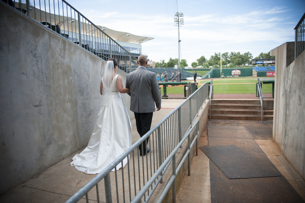 Melanie got to walk out of the dugout to the aisle. So cool!
