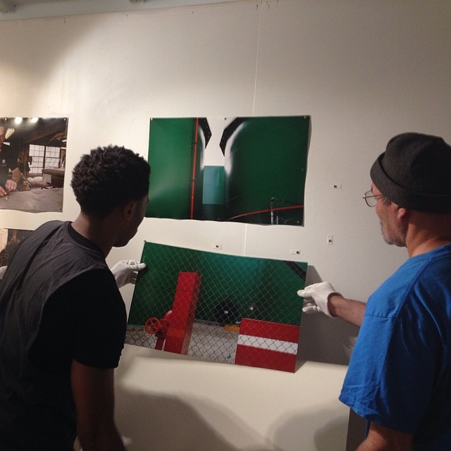 Prints being put up with cool rare earth magnets for 'Heart of The South Bronx' opening tomorrow Saturday. Sun should come up. #bronxtrades #thepoint (at THE POINT's Art Container, 1391 Lafayette avenue, Bronx, NY, 10474)