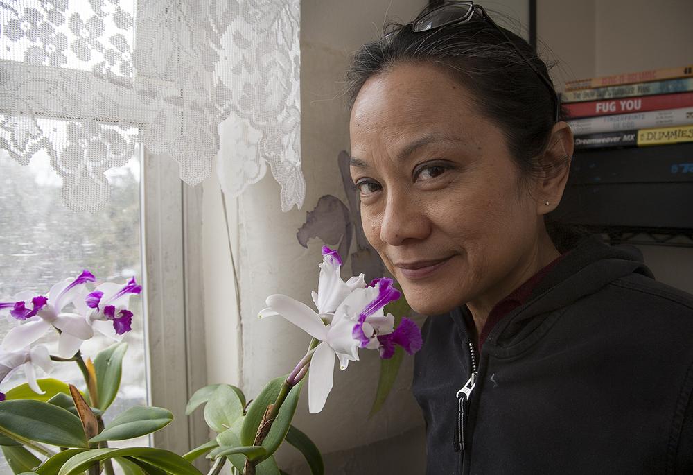 Skowmon Hastanan -conceptual artist-in her Orchid Garden.