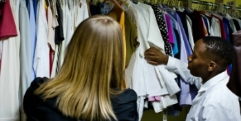 WEN clients browse through donated career wear in the clothing bank
