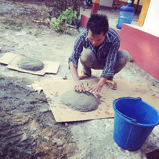 Getting ready for rainy season, Jobson makes stepping stones out of leftover concrete with leaf embossing #pointbmyanmar #prototype #designtrainingcenter #mawlamyineuniversity