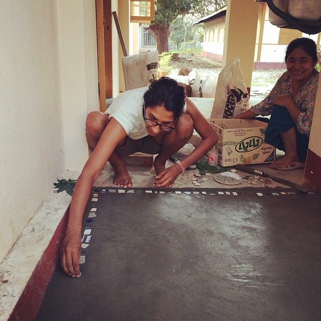 Start where you are: pointB trainer, Jobson, installed a new kitchen sink and laid down fresh concrete at the DT Center this week (yeah, he can do anything!)... We helped him by adding recycled pieces of tile to our new floors #pointbmyanmar #designtraini