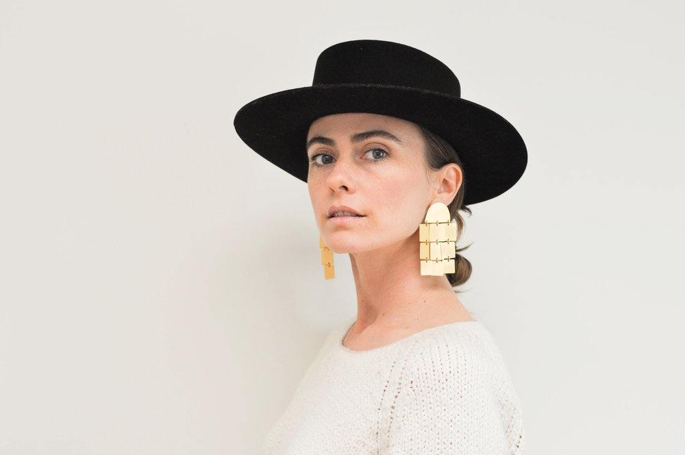 free-and-native-black_hat_gold_earrings_white_sweater_1 (1 of 1).jpg
