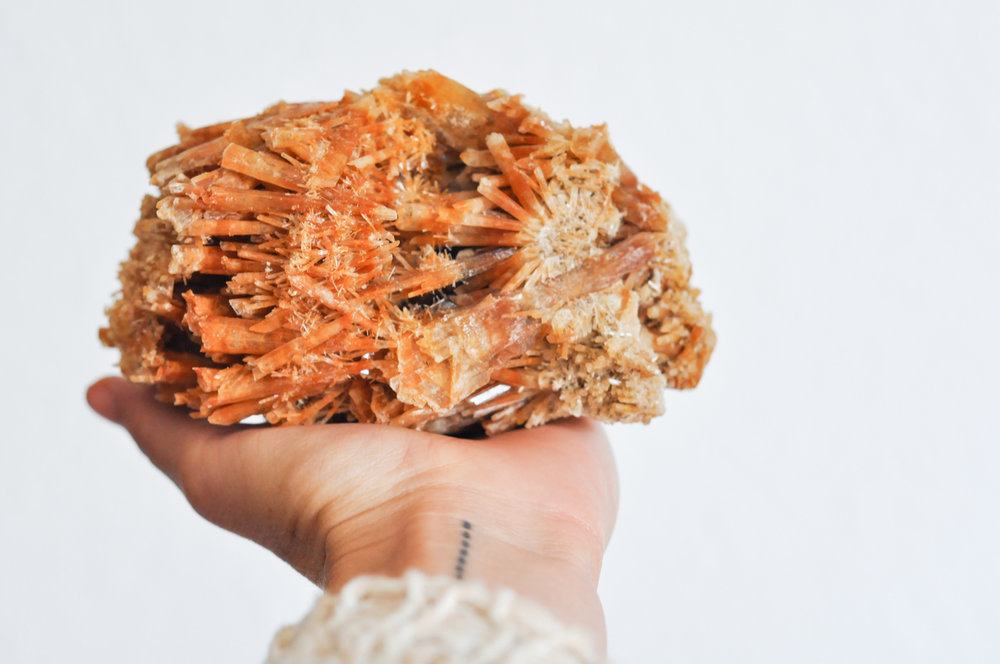 to-be-magnetic-hand-crystal-orange