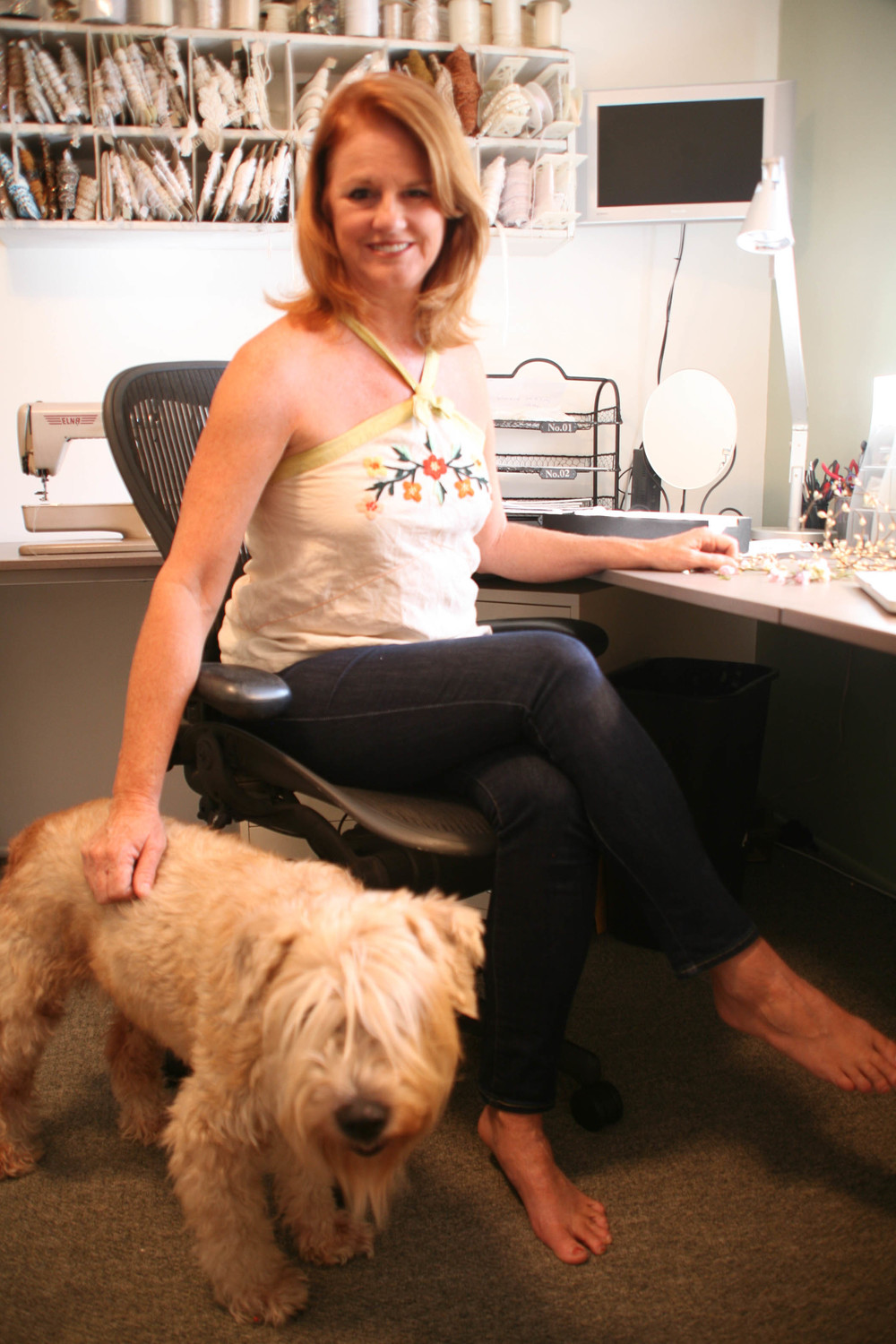 Jill in her studio with her wheaten terrier Indy