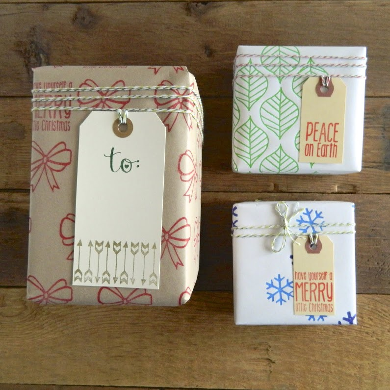 The finished product. Hand stamped paper and gift tags. Add some baker's twine and you have beautifully packaged gifts.