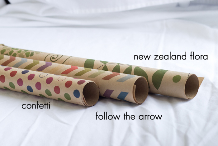 a sampling of gift wrap designed by Liora for her shop Toodles Noodles. confetti, follow the arrow, new zealand flora