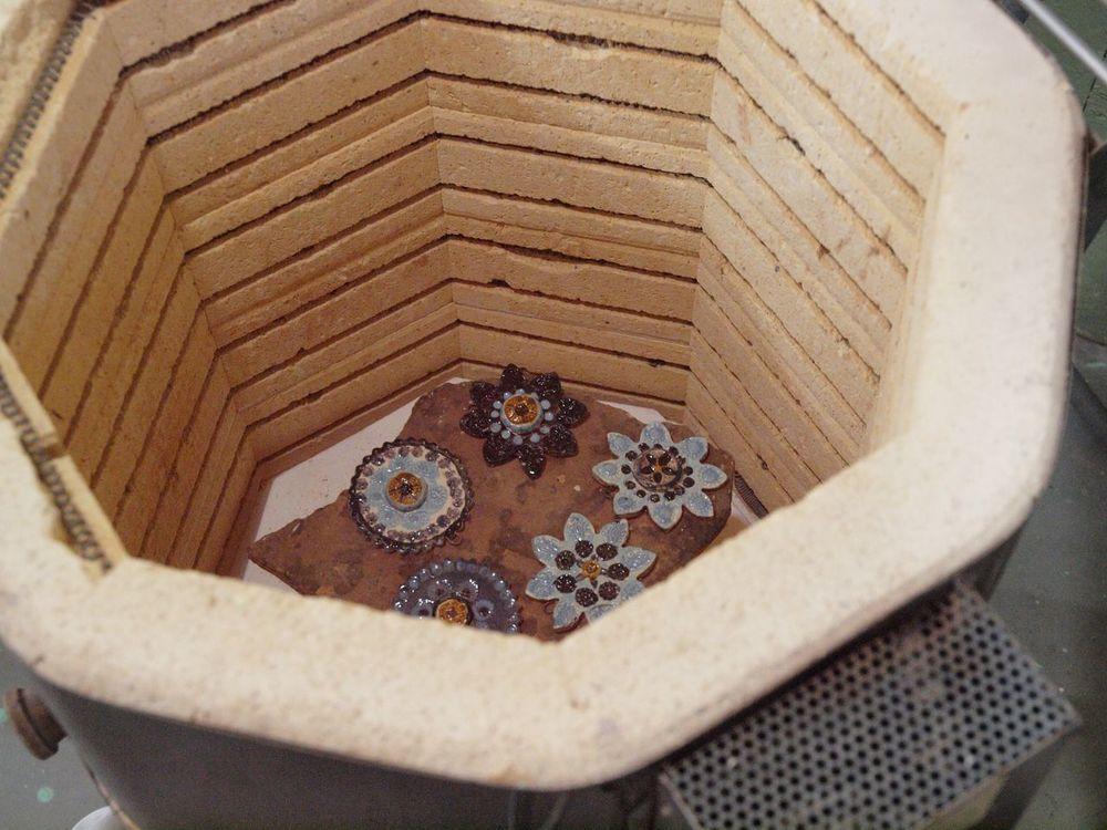 Ornaments still hot in kiln prior to raku firing.