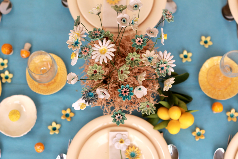 A perfect way to celebrate a Spring dinner. Flowers, mushrooms and lace bowls by Orly Design.