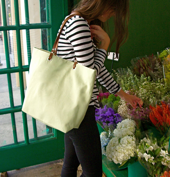 A tote   bag   perfect for picking up fresh flowers at the Farmer's Market.
