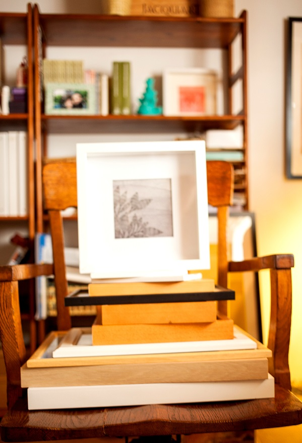 artwork and a stack of frames