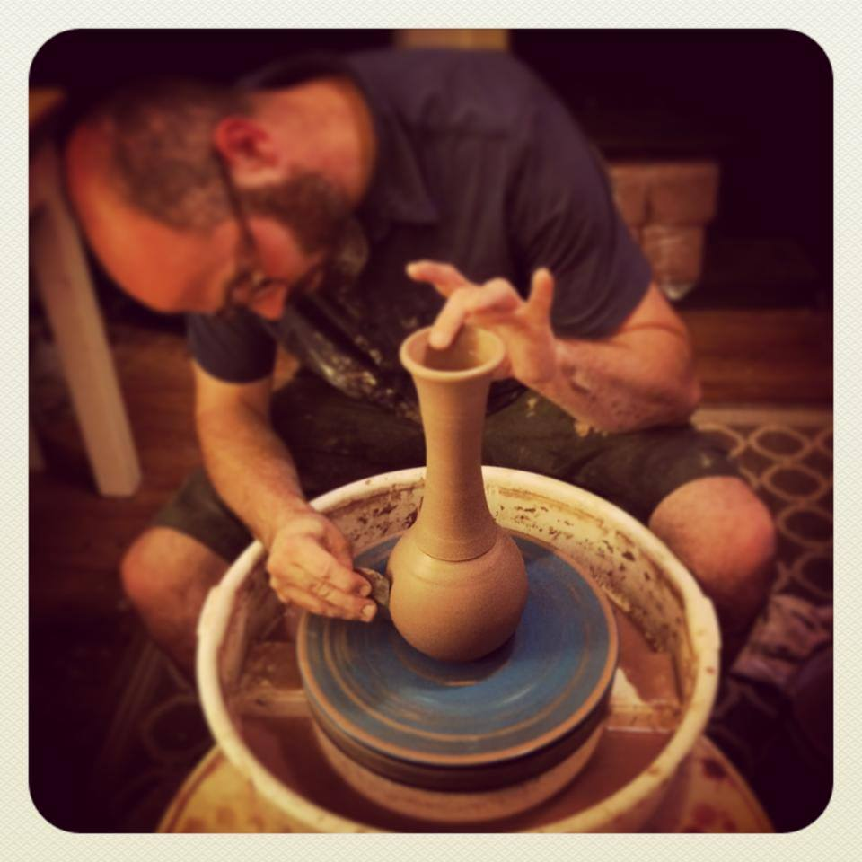 Scott creating one of the stoneware table vases available at Kirkwood Clay Pottery.
