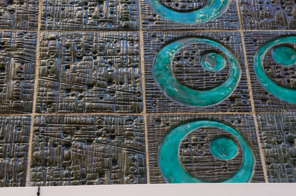 Barcelona - beautiful glazed sgraffito style tiles on a building facade 1960's ? I'm completely in love with any copper verdigris like colours. I'm not sure of the chemical origins of this glaze, buts its just gorgeous , and looks to be standing the test of time beautifully.