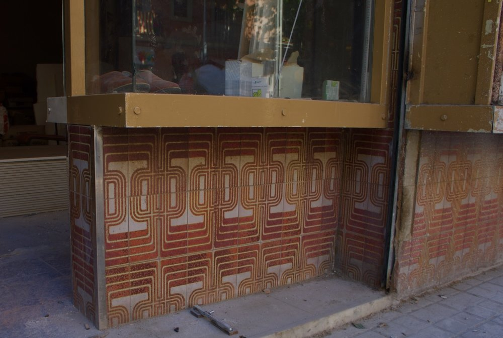 Barcelona , perfect example of a 1970's tile, i hope these are still around as the building was being renovated. I just hate how sometimes people just want to obliterate and discard any evidence of perceived cringe worthy eras. I think that if its high quality its worth considering saving, even sometimes ugly is an aesthetic, or becomes beautiful over time?