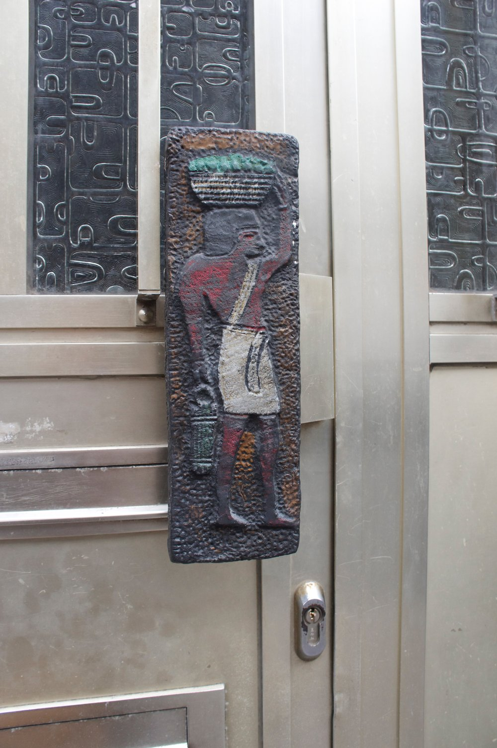 Egypt, Egypt, Egyption lover, couldn't resist :). Look at how this sand cast bronze handle has been hand painted, and look at this matching pressed metal panels on the door, such a beautiful way to secure you're property in the badlands of Brussels. It's really a gorgeous place but it does have a slightly harder edge than it's surrounding european capitols, however weirdly its actually one of those cities i'd consider moving to, even if fuze isn't what it used to be.