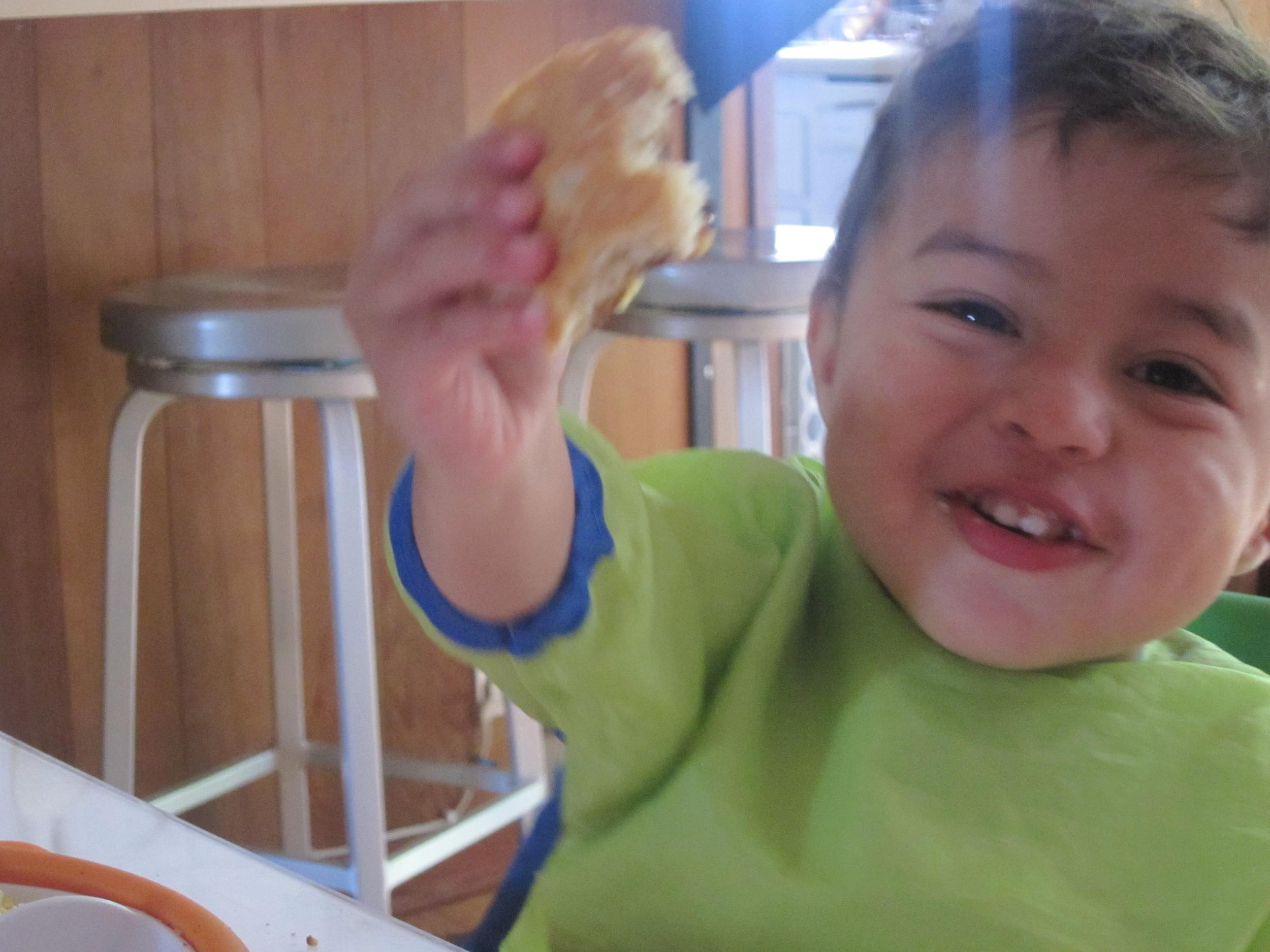Elian eats Arepas