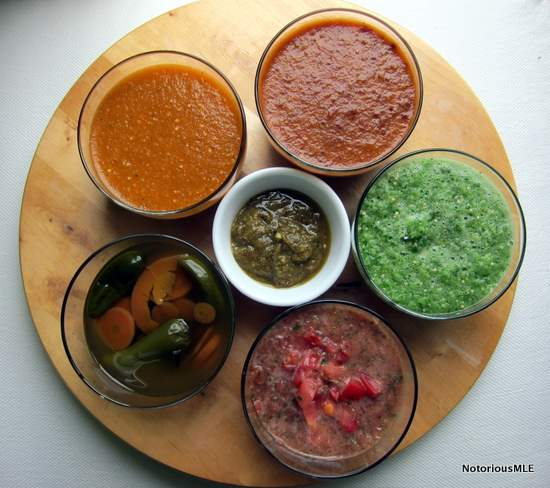 Clockwise from Top Left:Smoky Chipotle Salsa with Pan-Roasted Tomatillos, Toasted Guajillo Chile Salsa, Fresh Tomatillo Salsa, Chunky Fresh Tomato Salsa, Jalapenos en Escabeche. Middle:Roasted Fresh Chile Salsa