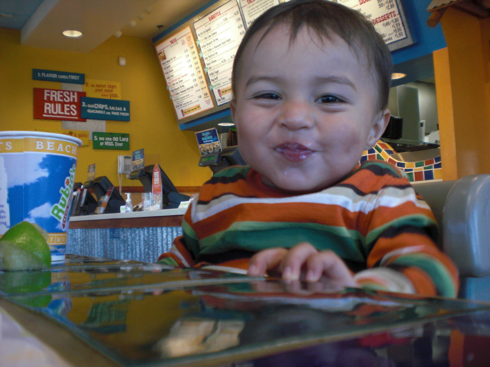 Elian digs the music at Rubios.  I dig that they have high chairs.