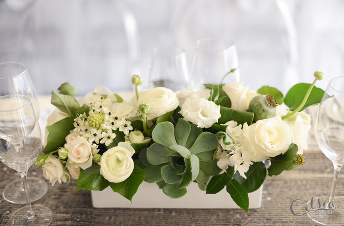 White wedding centerpiece with roses, ranunculus, lisianthus, ornitho, succulents and ivy by Celsia Floral.