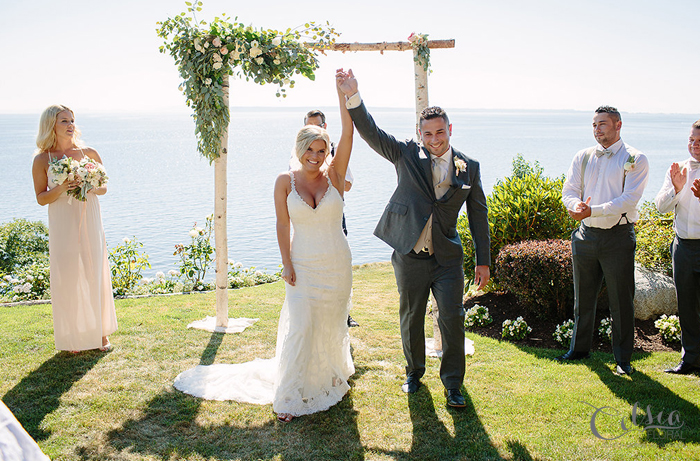 Ceremony arch with floral garland, by Celsia Floral.