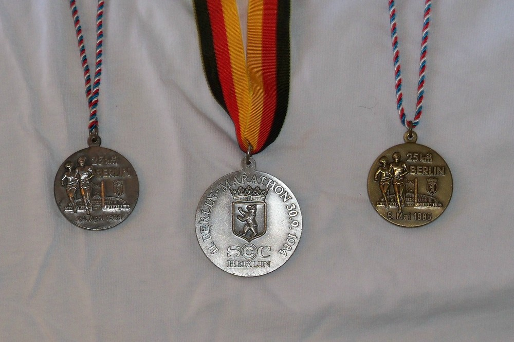 "Participation ""medals"" for two 25Ks and the Berlin Marathon"