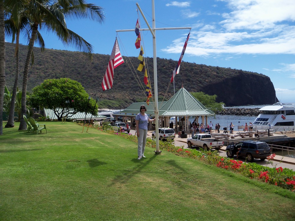 Kerry beneath the flags at Manele Bay, Lanai, June 26, 2014