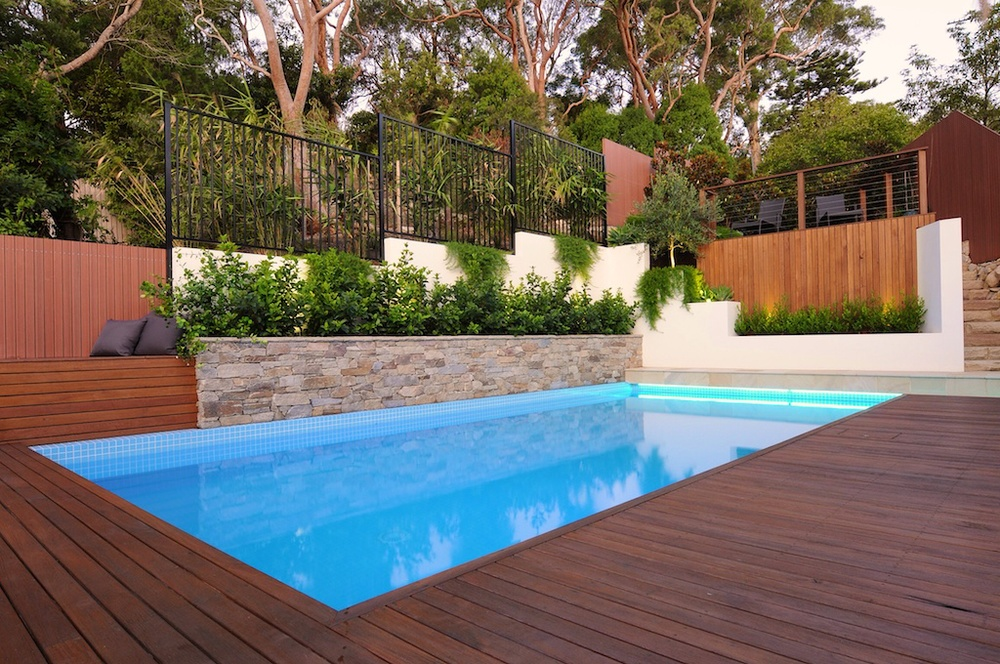 Sylvania, NSW Stunning landscape overhaul of a steep block including renovated poll and added structural landscape areas