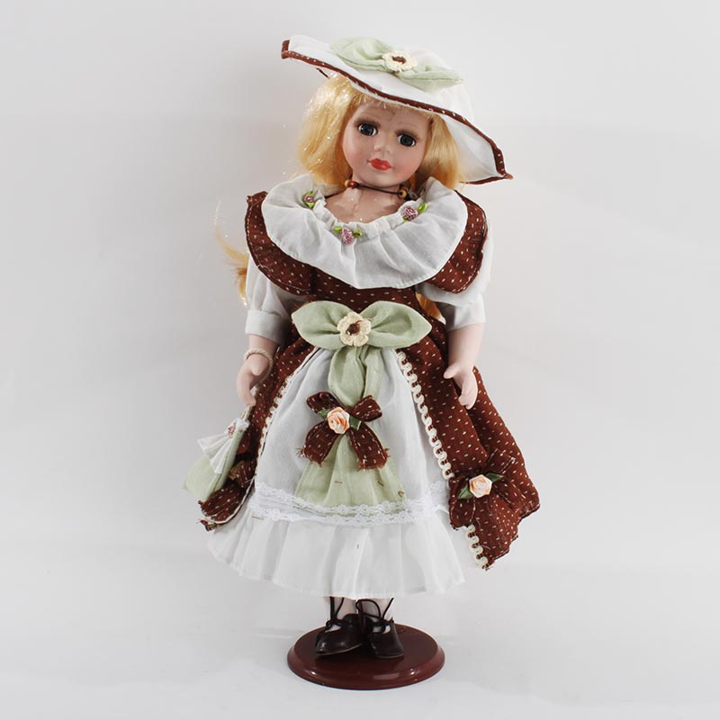 €24 PORCELAIN DOLL DECO W/FABRIC DRESS 20Χ20Χ41