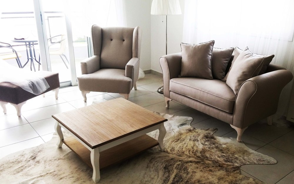 Living Room - Featuring Sofas, Armchairs, Center & Console Tables and more.