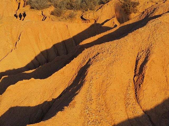 The clay dongas that go by the name of The Badlands are tucked away in the valley and wait to be found by foot. #porcupinehills #overberg #discoverberg #groenlandberg #accomodation #dongas #clay