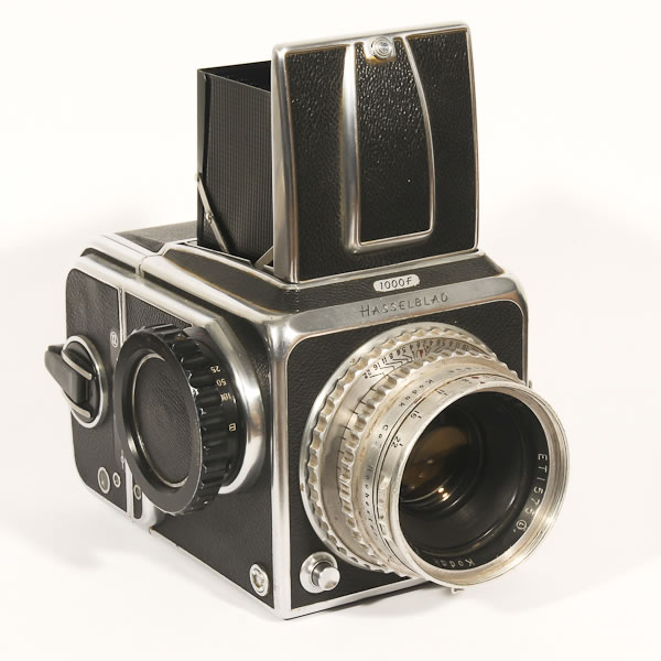Hasselblad Camera 1000F   1952-1957. Replacement model for the 1600F which was the world's first 6x6cm SLR with interchangeable film magaizines. Both models had shutter problems which is unlike the reputation they have for quality that has developed since then.