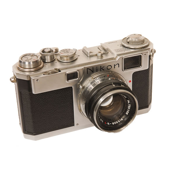 Nikon S2 Camera   1954-1958. Avery popular Nikon rangefinder 35 mm camera. Over 56,000 were produced. The first Nikon camera to have the 24x36mm format.  Nikon was founded 1917 as Nippon Kogaku K.K.. Until after WWII they made specialty optical devices. It wasn't until 1946 that they made their first camera and changed their name to Nikon, a contraction of the former corporate name.