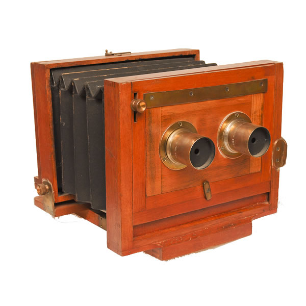 Scovill Stereo 4 1/4 x 6 1/5   C 1890's. This is a tailboard field view camera with an unusual stereo lens board. Manufacturing cameras from 1889 to 1907 under several permutations of the Scovill name.