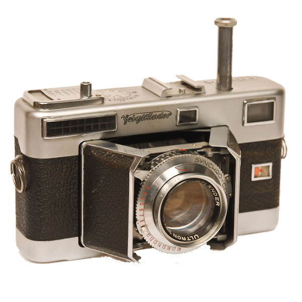 Voigtlander Vitessa   1954. 35mm folding camera with barn doors in front. The long plunger extending from the top of the camera was powered a fast winding system. From that it got its name Vitessa.