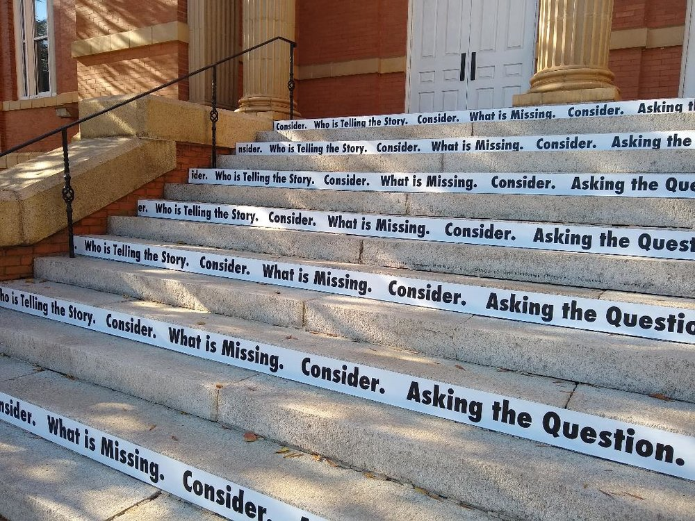 Consider , 2018 (detail)  Site-specific black and white vinyl text, 14 concrete stairs (Winthrop University/The Rutledge Stairs)   Consider  is a site-specific vinyl text piece that invites viewers to think critically about what they see.  Strips of black and white vinyl text have been attached to alternating risers allowing for a full reading and interaction.