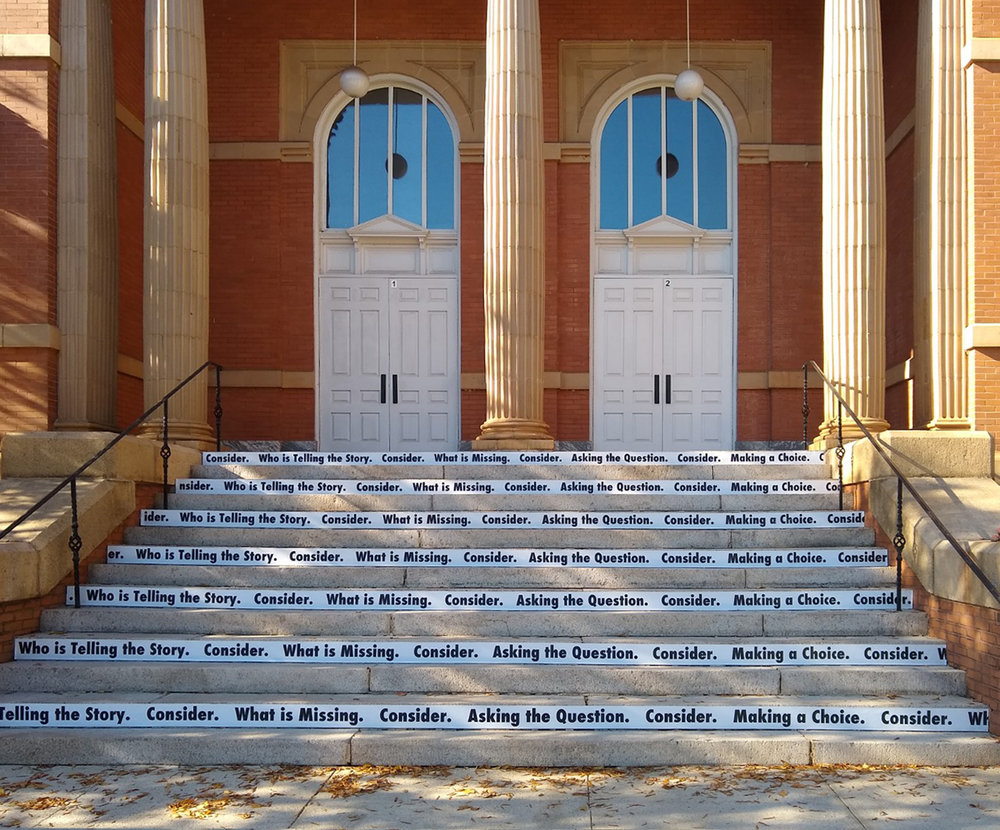 Consider , 2018  Site-specific black and white vinyl text, 14 concrete stairs (Winthrop University/The Rutledge Stairs)   Consider  is a site-specific vinyl text piece that invites viewers to think critically about what they see.  Strips of black and white vinyl text have been attached to alternating risers allowing for a full reading and interaction.