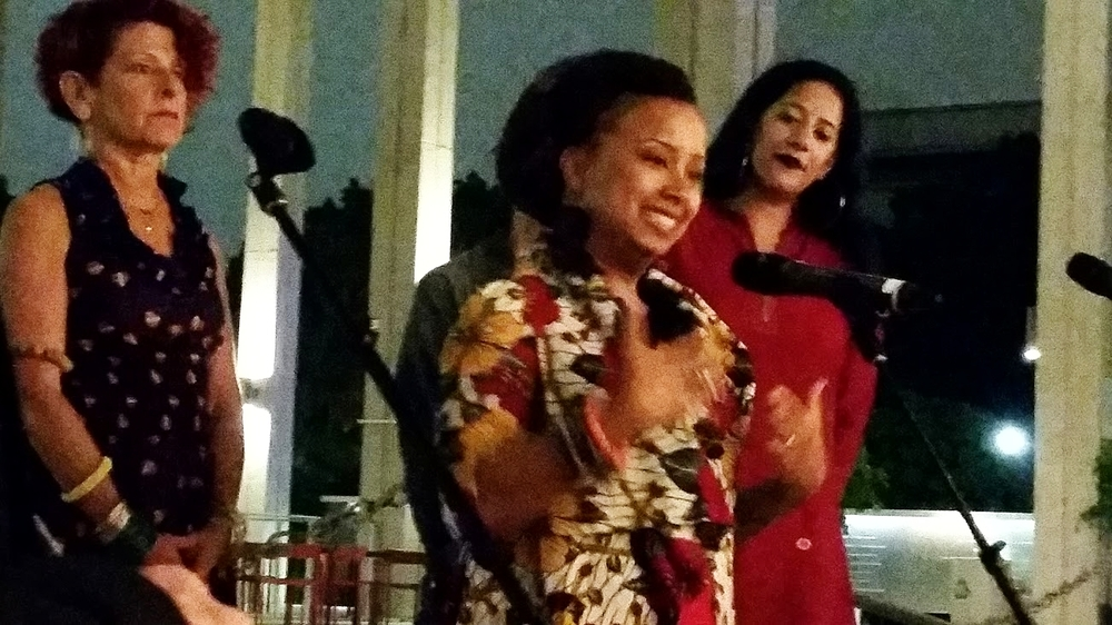 Shelby Williams-González speaks at the the opening night reception for Moves After Dark at the music center. (l-r: Linda Yudin, Artistic Director Viver Brasil; Shelby Williams-González, Choreographer and dancer, Viver Brasil; Achinta McDaniels, Artistic Director, blu13)