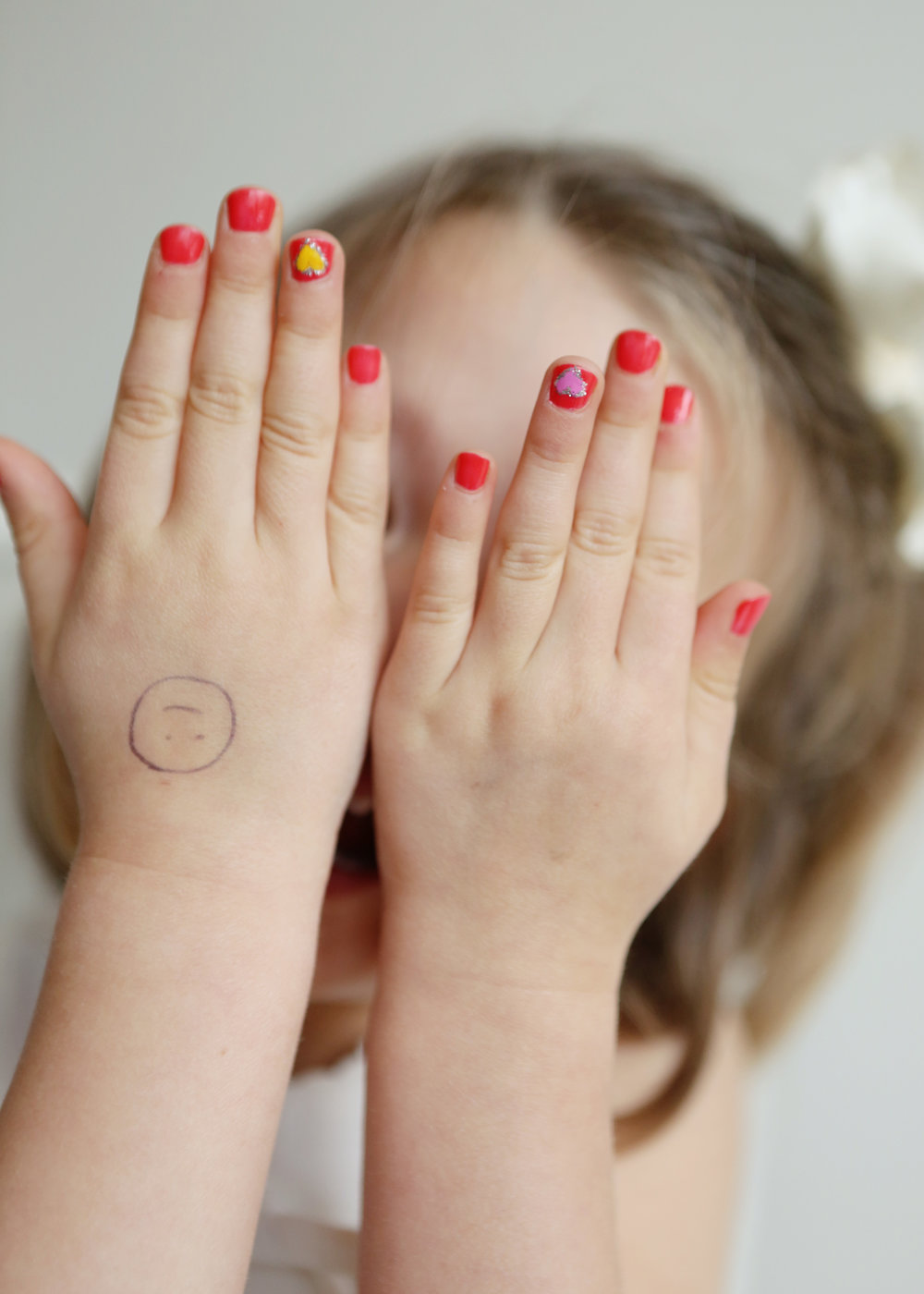 NJ and NYC based lifestyle photographer | Jennifer Lavelle Photography |  children and families, newborn, lifestyle, interiors, food and travel.  Little girl's painted nails.